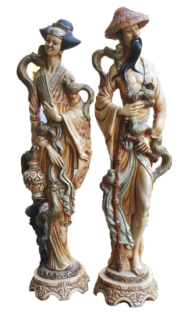 Matching pair of 20 inch tall faux ivory statues of a geisha and a daimyo