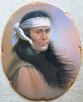 Portrait of Native American on oval wooden board