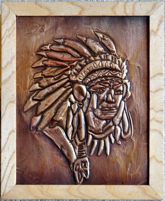 Embossed copper foil artwork depicting a Native American in headdress