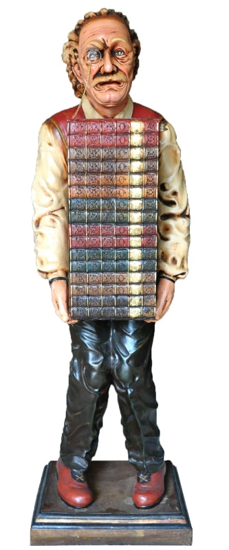 Fiberglass sculpture of Albert Einstein holding a stack of books which is actually a wooden cabinet