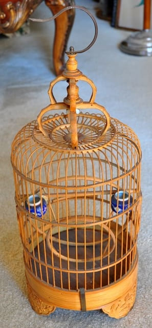 Artistic Asian bamboo bird cage with porcelain feeders