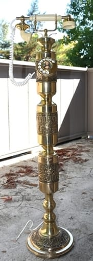 Tall French style brass telephone with ornate design