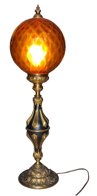 Ornate parlor style table lamp with huge amber glass globe