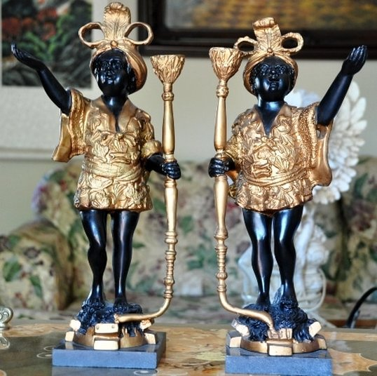Pair of gilt blackamoor greeter figural candlesticks