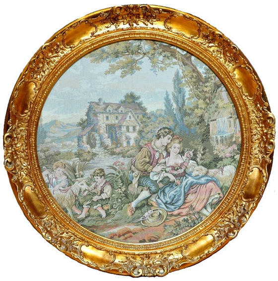 Framed round tapestry depicting a French Country scenery