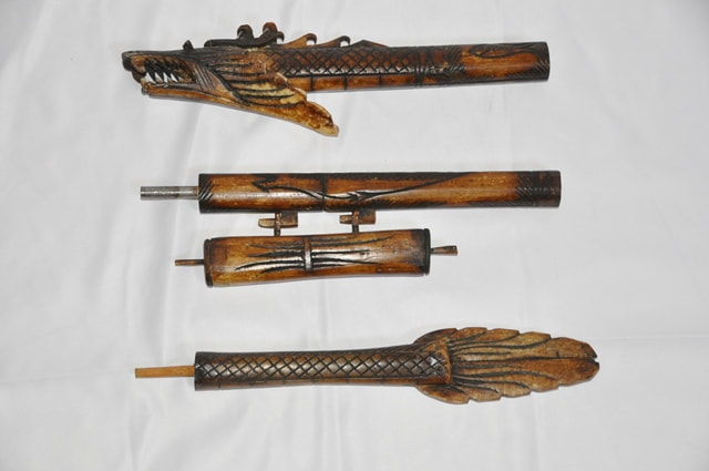 Indonesian dragon shaped carved bone blow dart gun from Borneo