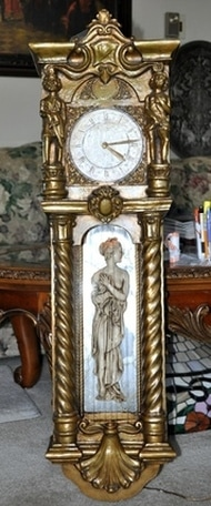 Mid-century wall clock with oil rain fountain lamp and multiple figures