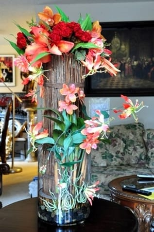 Silk floral arrangement of flowers and orchids