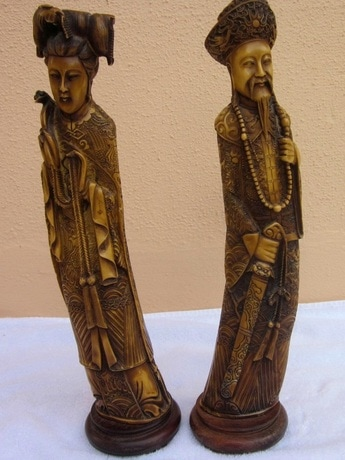 Pair of faux ivory Oriental sculptures of emperor empress