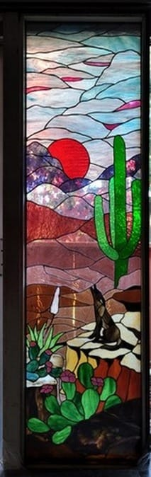 Masterpiece stained glass window door of cayote howling in the desert landscape