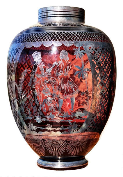 Cranberry glass vase with intricate silver overlay artwork
