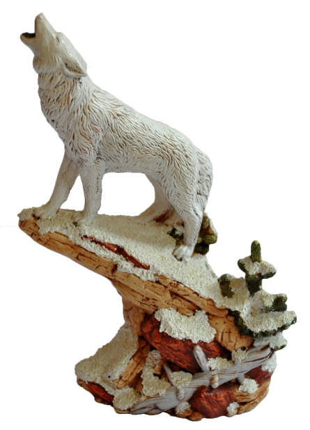 Ceramic sculpture of a wolf howling on a ledge in snowy winter