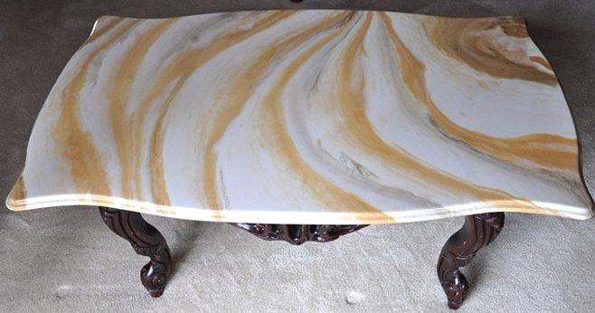 Vintage marble top coffee table with ornate wood frame