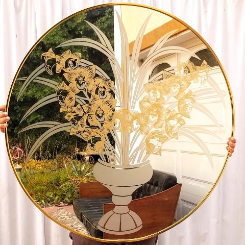 Round mirror with etched cymbidium bouquet artwork by Robert Slimbach