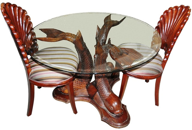 Carved teak wood koi fish base dining table and shell shaped chairs from Indonesia